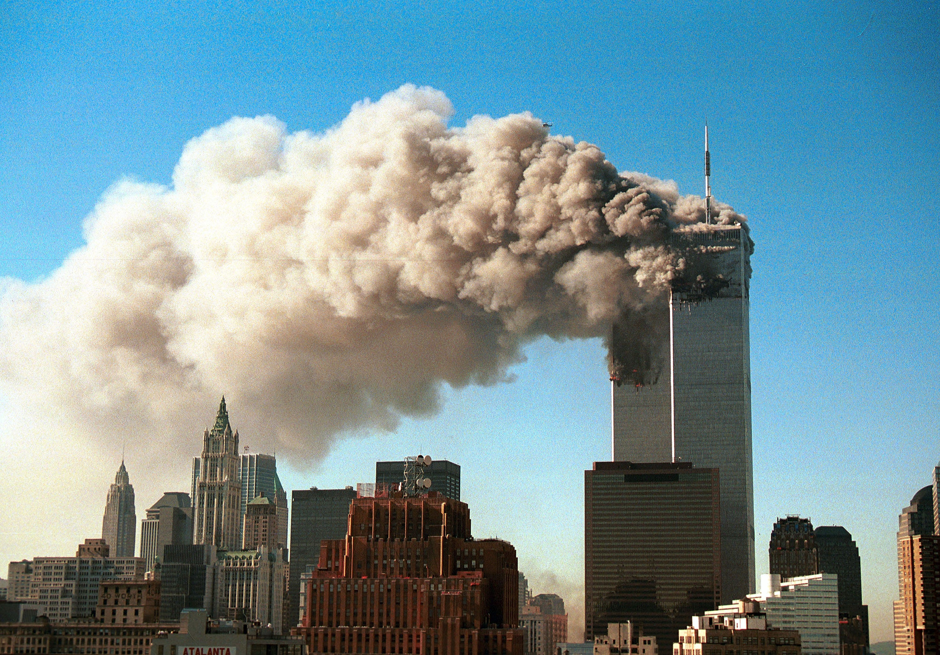 Smoke pours from the twin towers of the World Trade Center.