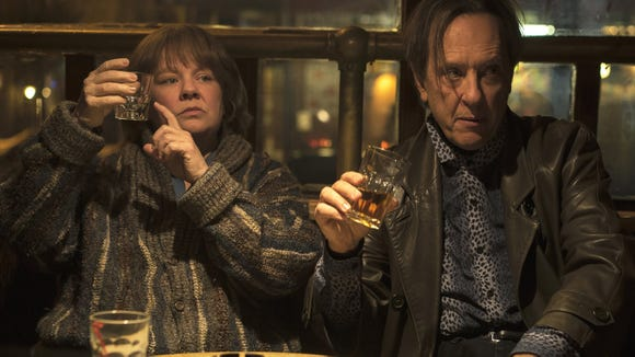 "Melissa McCarthy (with Richard E. Grant) plays writer-turned-forger Lee Israel in the biopic ""Can You Ever Forgive Me?"""