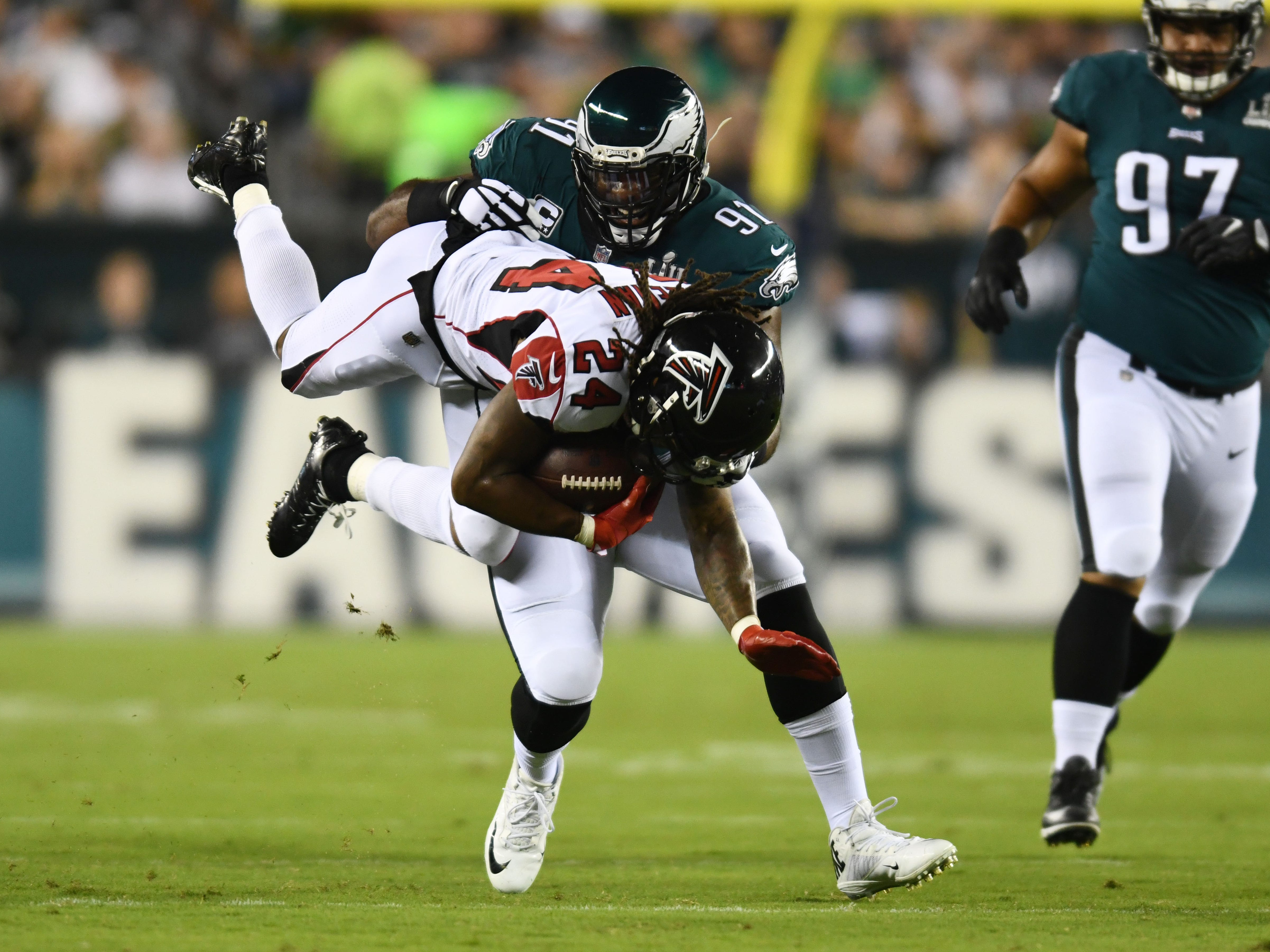 Philadelphia Eagles defensive end Fletcher Cox (91) tackles Atlanta Falcons running back Devonta Freeman (24) in the first quarter at Lincoln Financial Field.