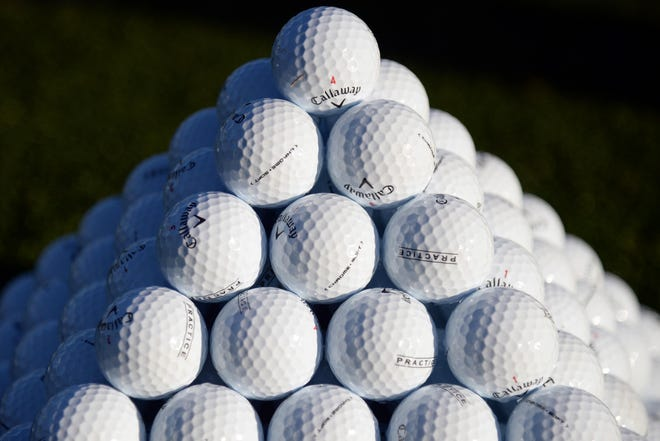 A detailed view of a golf ball stack.