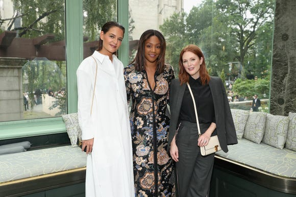 Katie Holmes, Tiffany Haddish and Julianne Moore pose backstage at Tory Burch.