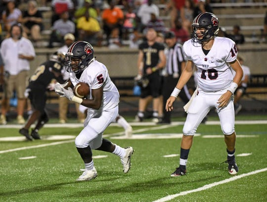 Belton Honea Path senior Camden Bratcher hands off to Jaquez Dixon during the third quarter at TL Hanna High School in Anderson on Friday, September 7, 2018.