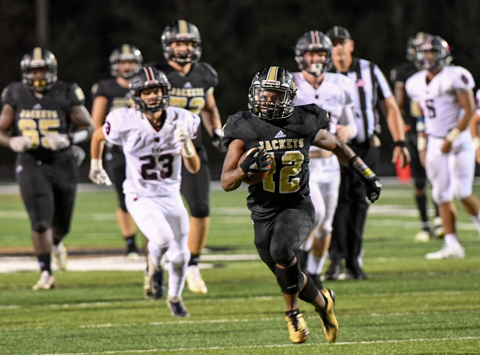 TL Hanna running back Erick Lopez runs by Belton Honea Path sophomore Wes Newton during the third quarter at TL Hanna High School in Anderson on Friday, September 7, 2018.