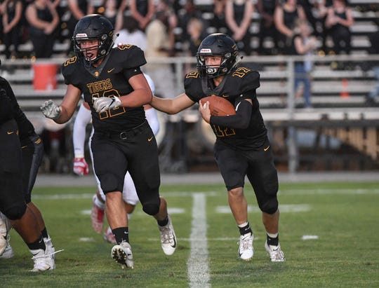 Crescent sophomore Clay Rebrick runs during the first quarter at Crescent High School in Iva on Friday, September 7, 2018.