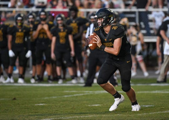 Crescent senior Dawson Merk passes during the first quarter at Crescent High School in Iva on Friday, September 7, 2018.
