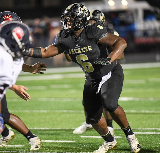 TL Hanna senior Zacch Pickens with Belton Honea Path junior Quientin Smith during the third quarter at TL Hanna High School in Anderson on Friday, September 7, 2018.
