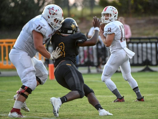 Palmetto quarterback Blair Garner fades back to pass during the first quarter at Crescent High School in Iva on Friday, September 7, 2018.