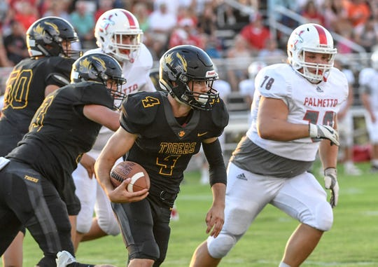 Crescent senior Murphy McBride runs with the football during the game with Palmetto in Iva on Friday, September 7, 2018.