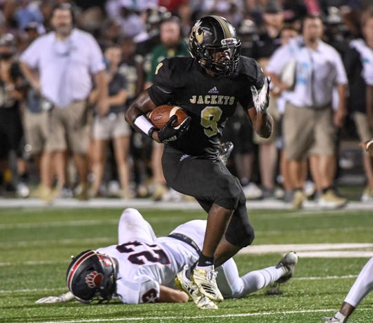 TL Hanna senior Jay Lagroon runs over Belton Honea Path sophomore Wes Newton during a home game in September.