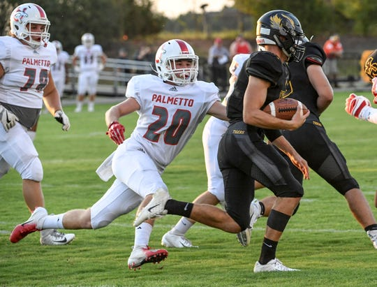 Palmetto Chase Froedge reaches for Crescent senior Murphy McBride during the first quarter at Crescent High School in Iva on Friday, September 7, 2018.