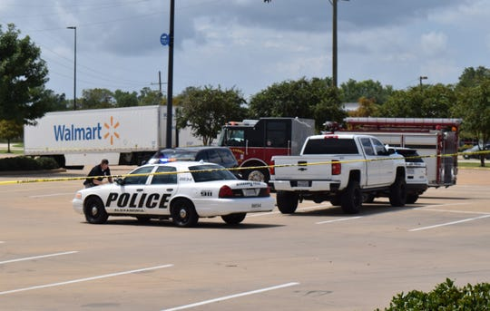 Alexandria Police investigate the scene in the parking lot at the Wal-Mart on Coliseum Boulevard, where a man was shot Saturday, Sept. 8, 2018. Police say the man later died. A woman was taken into custody.