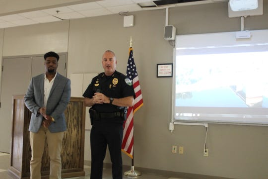 Chief Jerrod King talks about seeing a video produced by Keldric Bonton (left) and wanting to work with him on a recruiting video for the department. The video was unveiled on Friday.