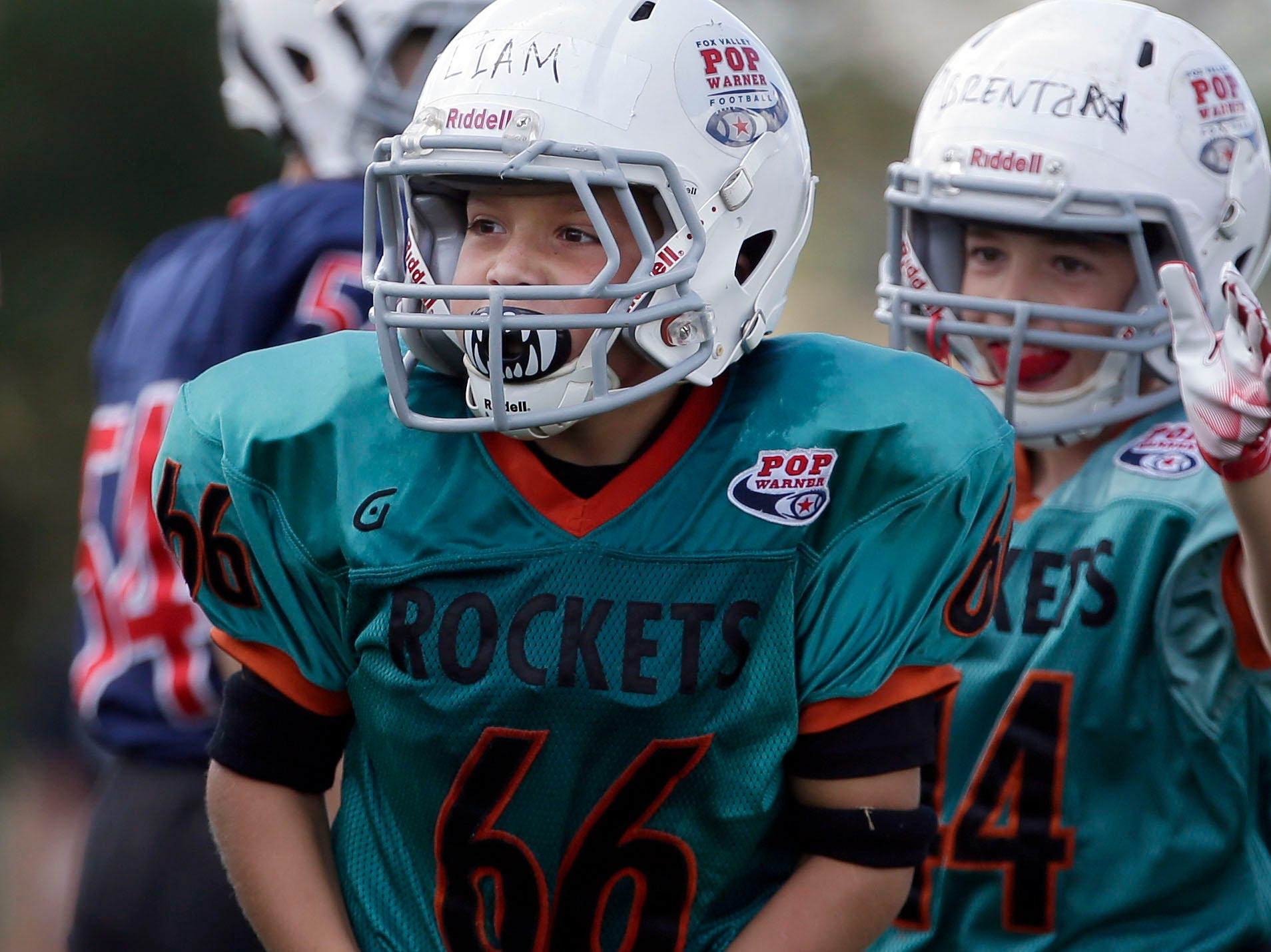 Liam Kelley of the Rockets flexes after a tackle against the Patriots as Fox Valley Pop Warner Football opens the season Saturday, September 8, 2018, at Plamann Park in Grand Chute, Wis.Ron Page/USA TODAY NETWORK-Wisconsin