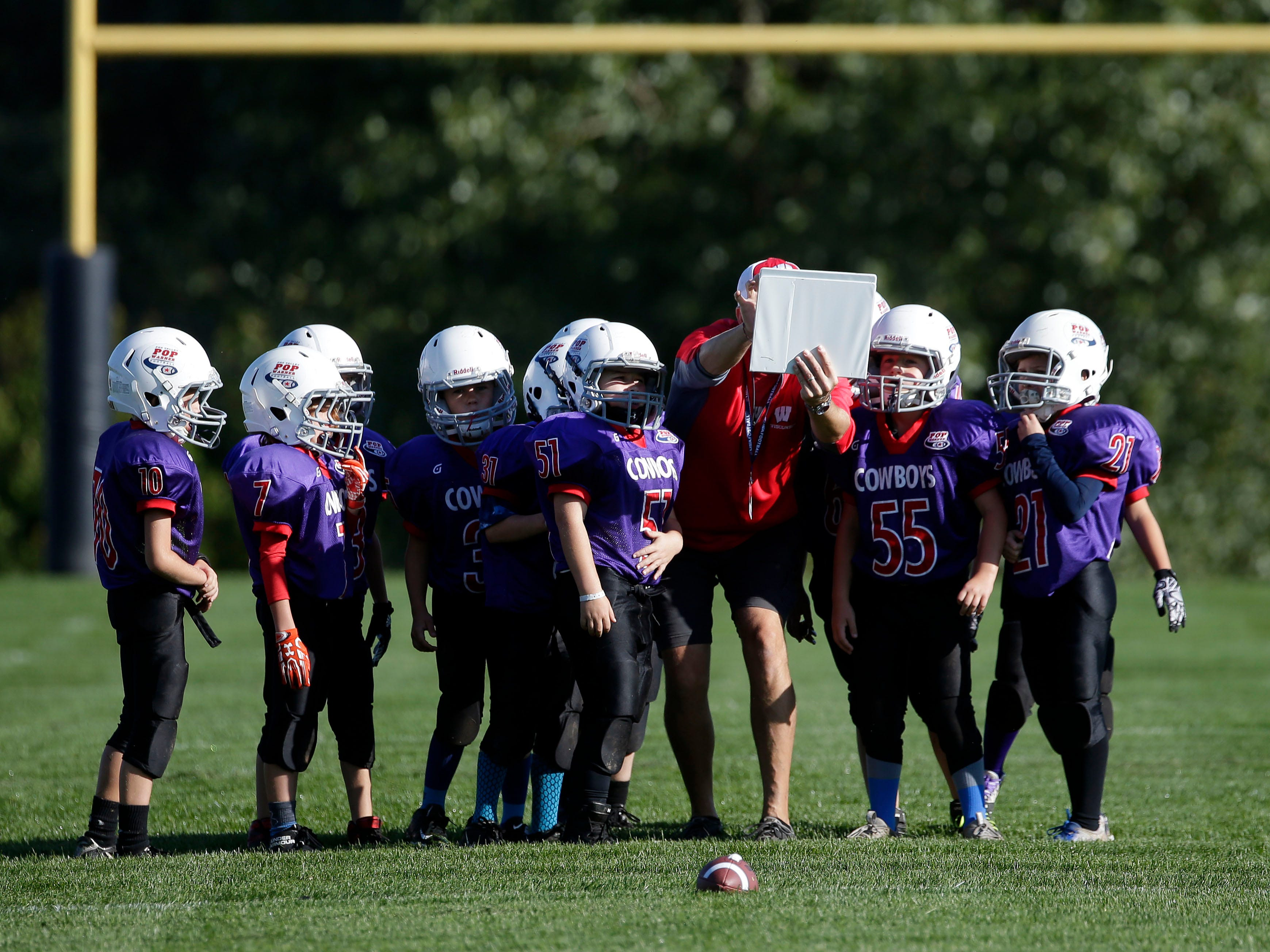 The Cowboys in the Mitey Mites Division play an early game as Fox Valley Pop Warner Football opens the season Saturday, September 8, 2018, at Plamann Park in Grand Chute, Wis.Ron Page/USA TODAY NETWORK-Wisconsin