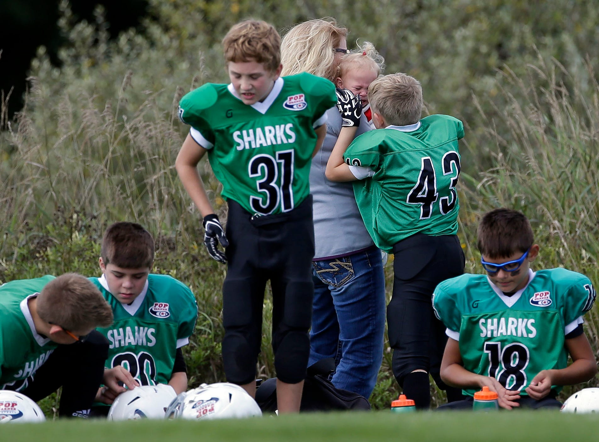 The sidelines can be busy before a game as Fox Valley Pop Warner Football opens the season Saturday, September 8, 2018, at Plamann Park in Grand Chute, Wis.