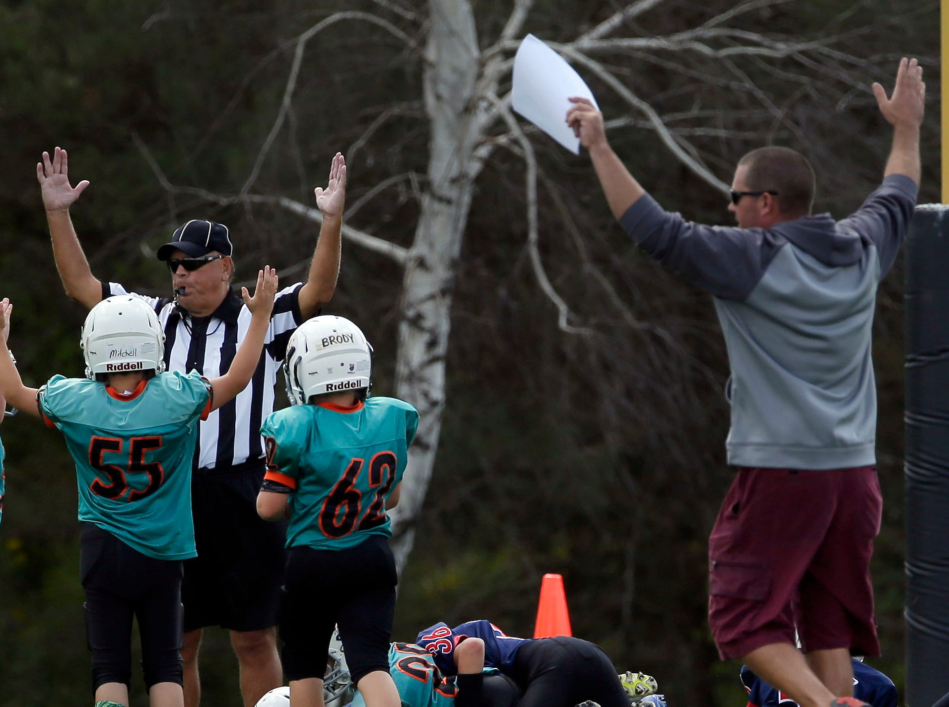 The Rockets and the referee signal a touchdown as Fox Valley Pop Warner Football opens the season Saturday, September 8, 2018, at Plamann Park in Grand Chute, Wis.Ron Page/USA TODAY NETWORK-Wisconsin
