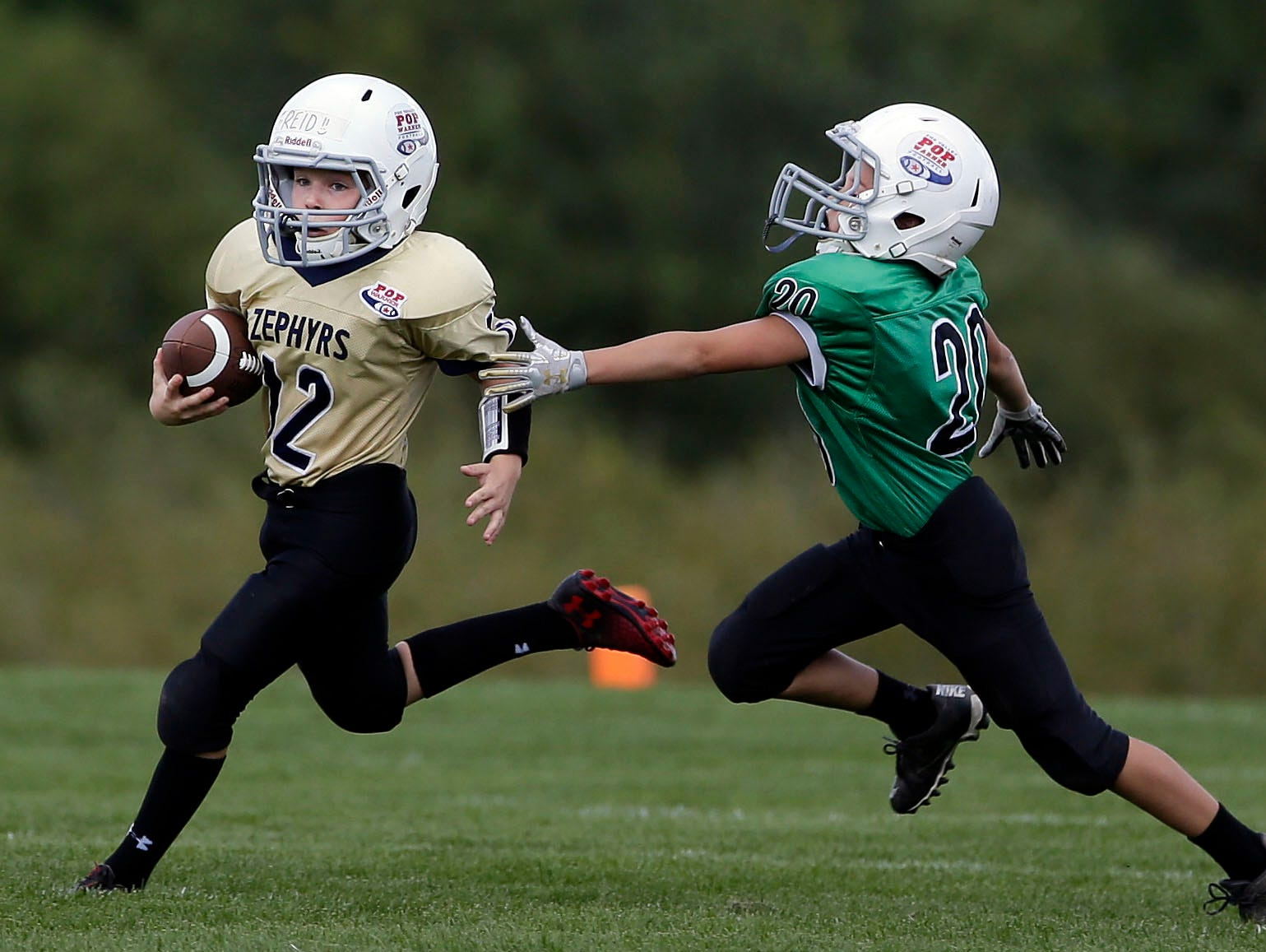 Travis Lindenberg of the Zephyrs gets away from Brogan Dodge of the Sharks as Fox Valley Pop Warner Football opens the season Saturday, September 8, 2018, at Plamann Park in Grand Chute, Wis.Ron Page/USA TODAY NETWORK-Wisconsin