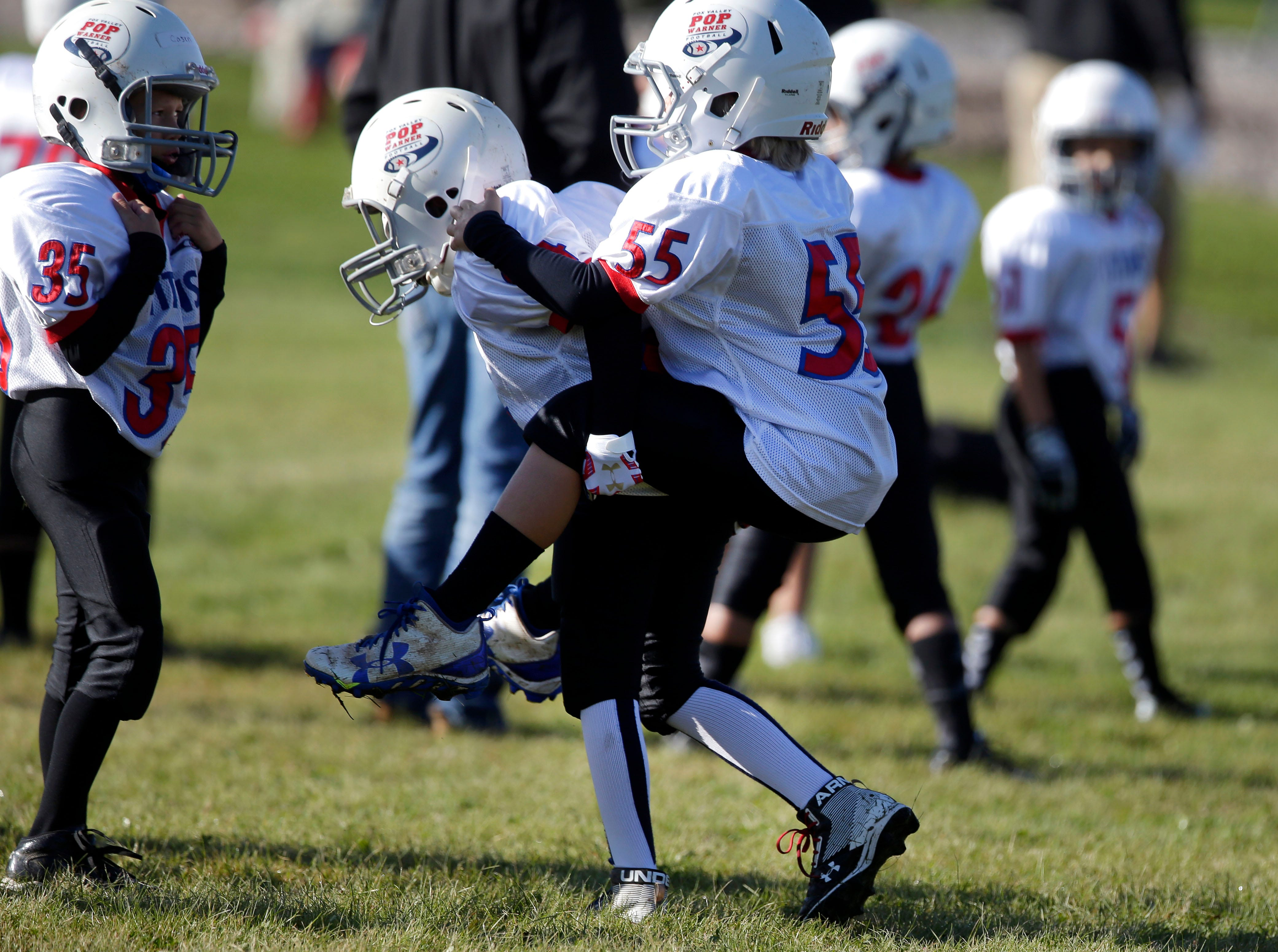 Players find time to horse around as Fox Valley Pop Warner Football opens the season Saturday, September 8, 2018, at Plamann Park in Grand Chute, Wis.Ron Page/USA TODAY NETWORK-Wisconsin