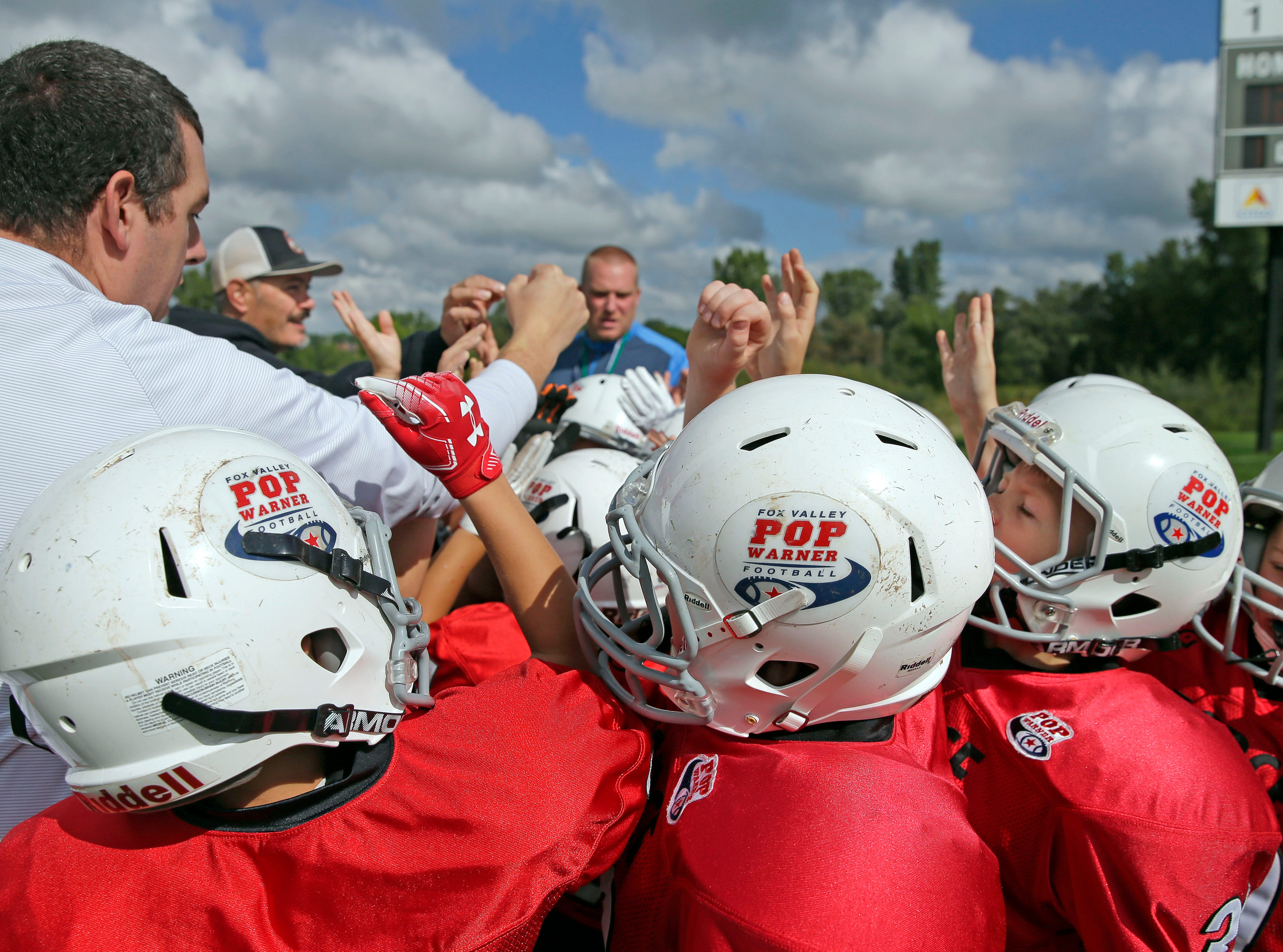 The Force gets ready to take the field as Fox Valley Pop Warner Football opens the season Saturday, September 8, 2018, at Plamann Park in Grand Chute, Wis.