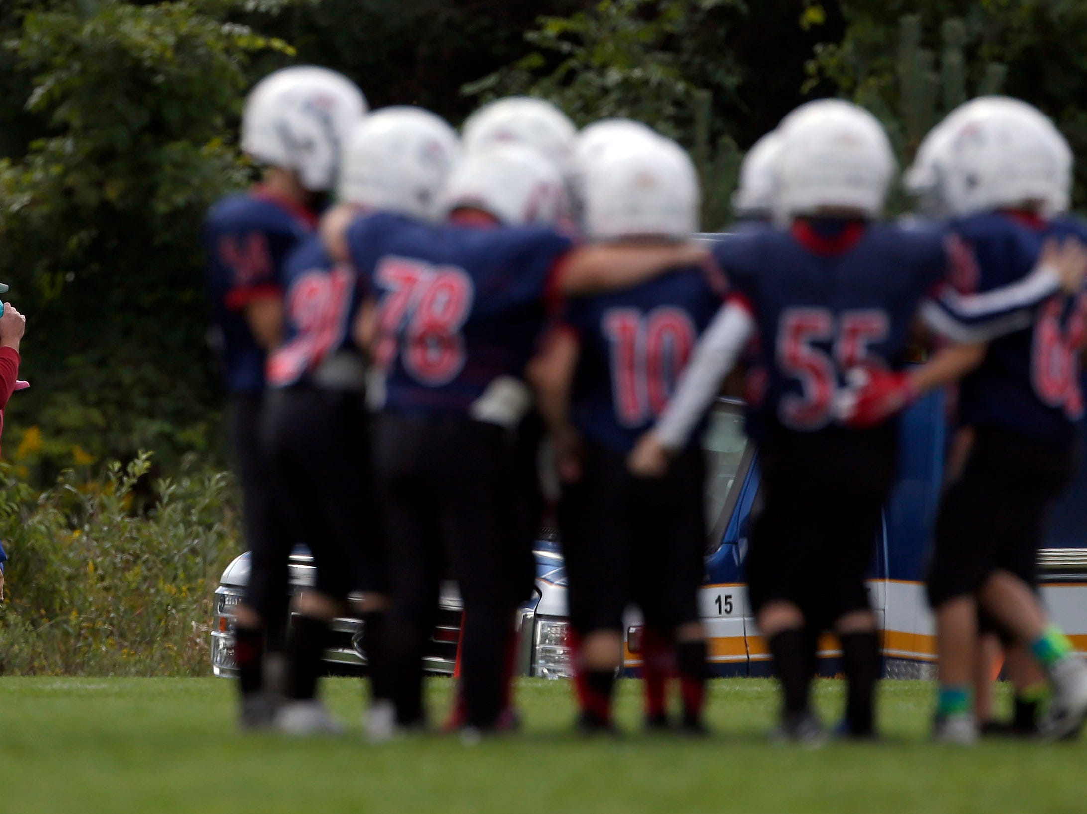 Families make their way to the sidelines as Fox Valley Pop Warner Football opens the season Saturday, September 8, 2018, at Plamann Park in Grand Chute, Wis.Ron Page/USA TODAY NETWORK-Wisconsin