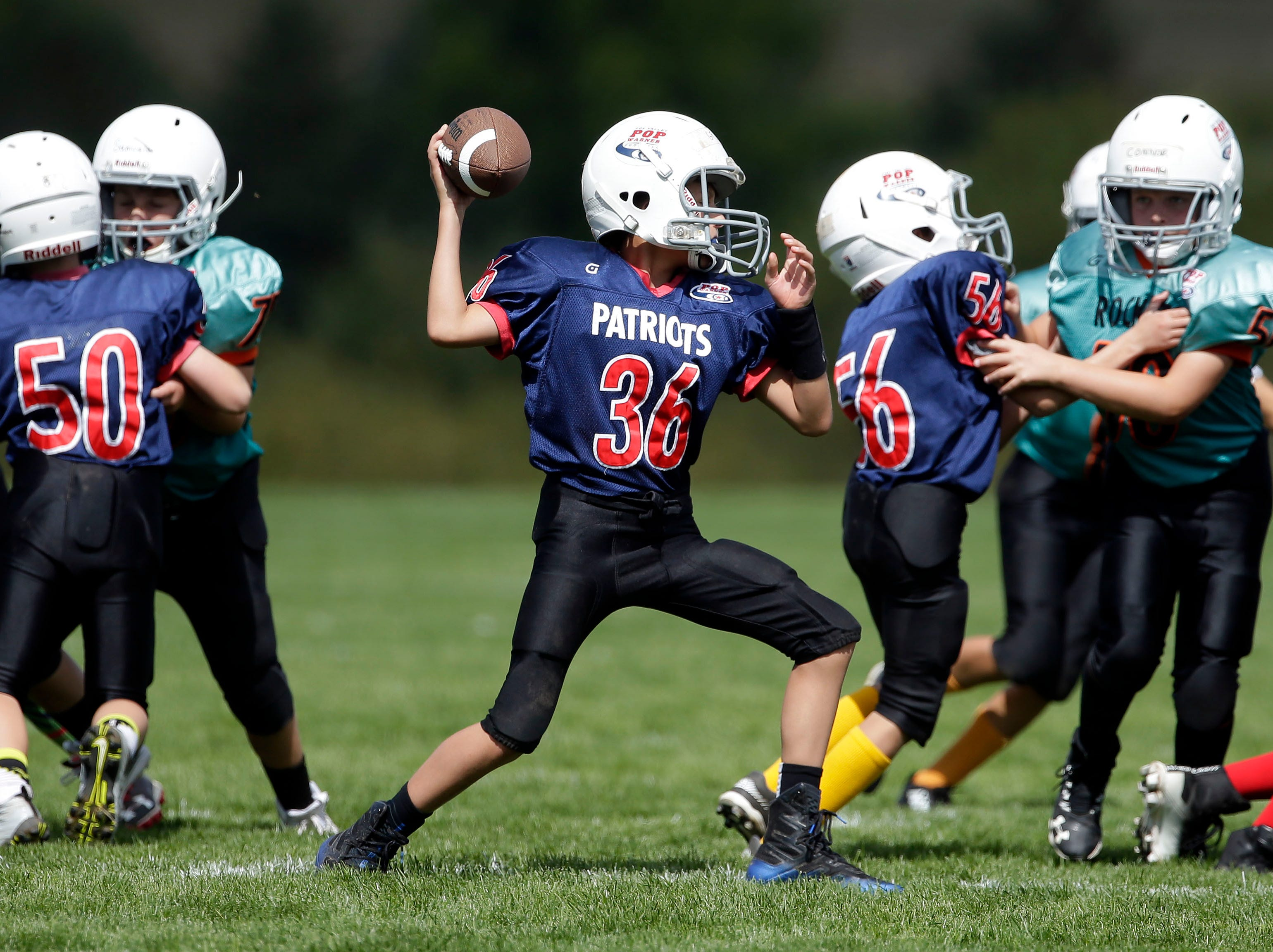 Griffin Heckert of the Patriots passes against the Rockets as Fox Valley Pop Warner Football opens the season Saturday, September 8, 2018, at Plamann Park in Grand Chute, Wis.Ron Page/USA TODAY NETWORK-Wisconsin