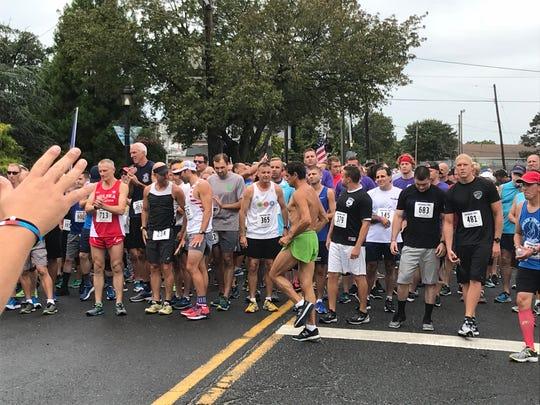 Runners at the start line for the 5K Fallen Heroes memorial run in Lake Como Sept. 8, 2018