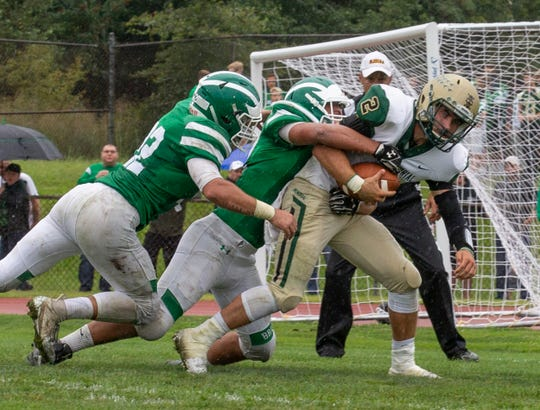Brick Memorial's Tyler Sindel gets caught in the backfield for a loss during first half action. Brick High School football vs Brick Memorial in Brick NJ on September 8, 2018.