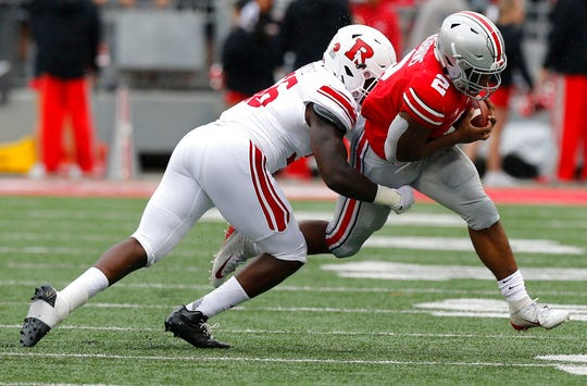 Rutgers linebacker Rashawn Battle, left, tries to tackle Ohio State running back J.K. Dobbins during the first half of an NCAA college football game Saturday, Sept. 8, 2018, in Columbus, Ohio. (AP Photo/Jay LaPrete)