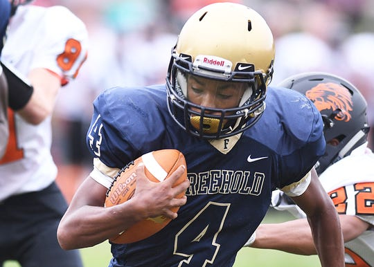 Freehold's Sha'Kim Shuler looks for running room as Freehold Borough defeats Middletown North 22-20 on 9/8/2018