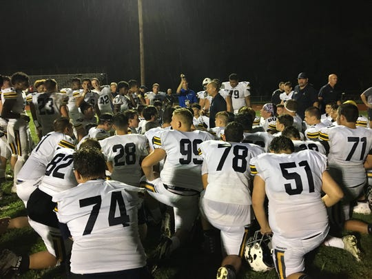 Toms River North coach Dave Oizerowitz addresses his players after  their stirring upset of Manalapan.