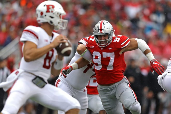Sep 8, 2018; Columbus, OH, USA; Ohio State Buckeyes defensive end Nick Bosa (97) moves in against Rutgers Scarlet Knights quarterback Artur Sitkowski (8) in the first half at Ohio Stadium.