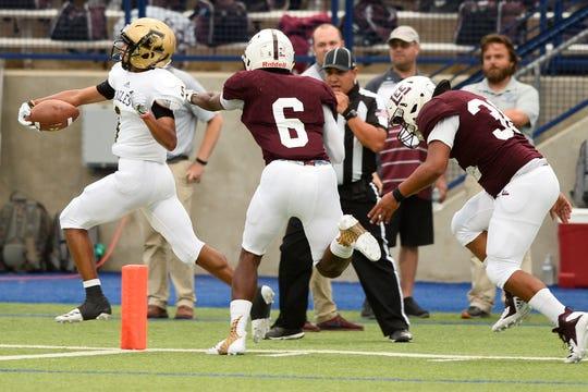 Abilene's Qua Hill scores a touchdown in front of Lee's Mykai Pertile (6) and Charlie Gonzales (36) Sept. 7, 2018, at Grande Communications Stadium.James Durbin/Reporter-Telegram