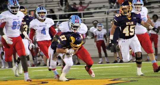 Wylie running back Bailey Hicks (27) bulls ahead near midfield on a good gainer Friday night against Lubbock Monterey.