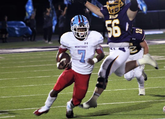 Damontrareis Lacy (7) of Lubbock Monterey gets by Wylie defender Carter Wright (56) and down the visitor sideline for a big gainer in the first half of Friday's game at Bulldog Stadium. Lacy scored twice for the Plainsview, who won 28-21.