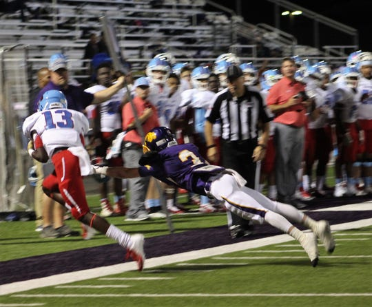 Lubbock Monterey receiver Tyrie Tipton (13) gets the tip of his toe down for a sideline catch against the defense of Wylie defensive back Jaden Speegle (3) in the first half of their non-district game at Bulldog Stadium. Monterey won, 28-21.