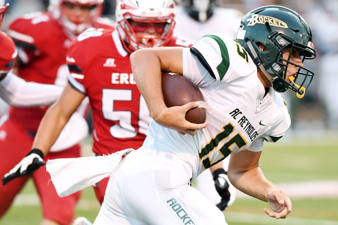 Alex Flinn carries the ball in the game at Erwin Sept. 7, 2018. Reynolds won, 56-26.