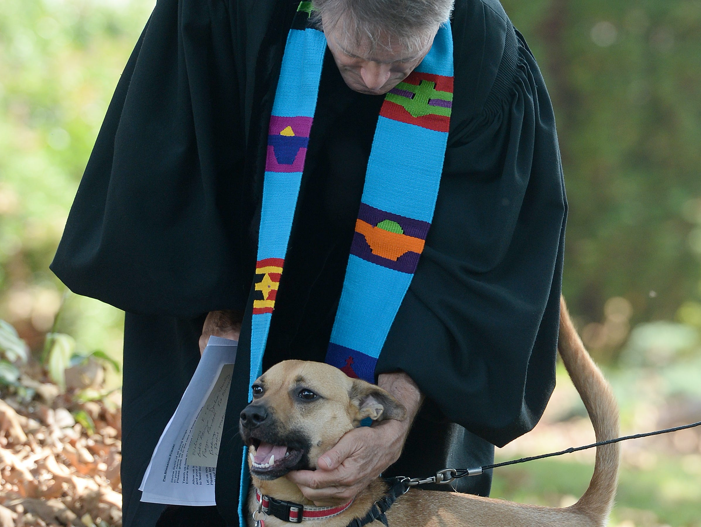 Randall Boggs calms his own dog, Marley, during the 10th Annual Blessing of the Pets at Mills River Presbyterian Church on Sept. 8, 2018.