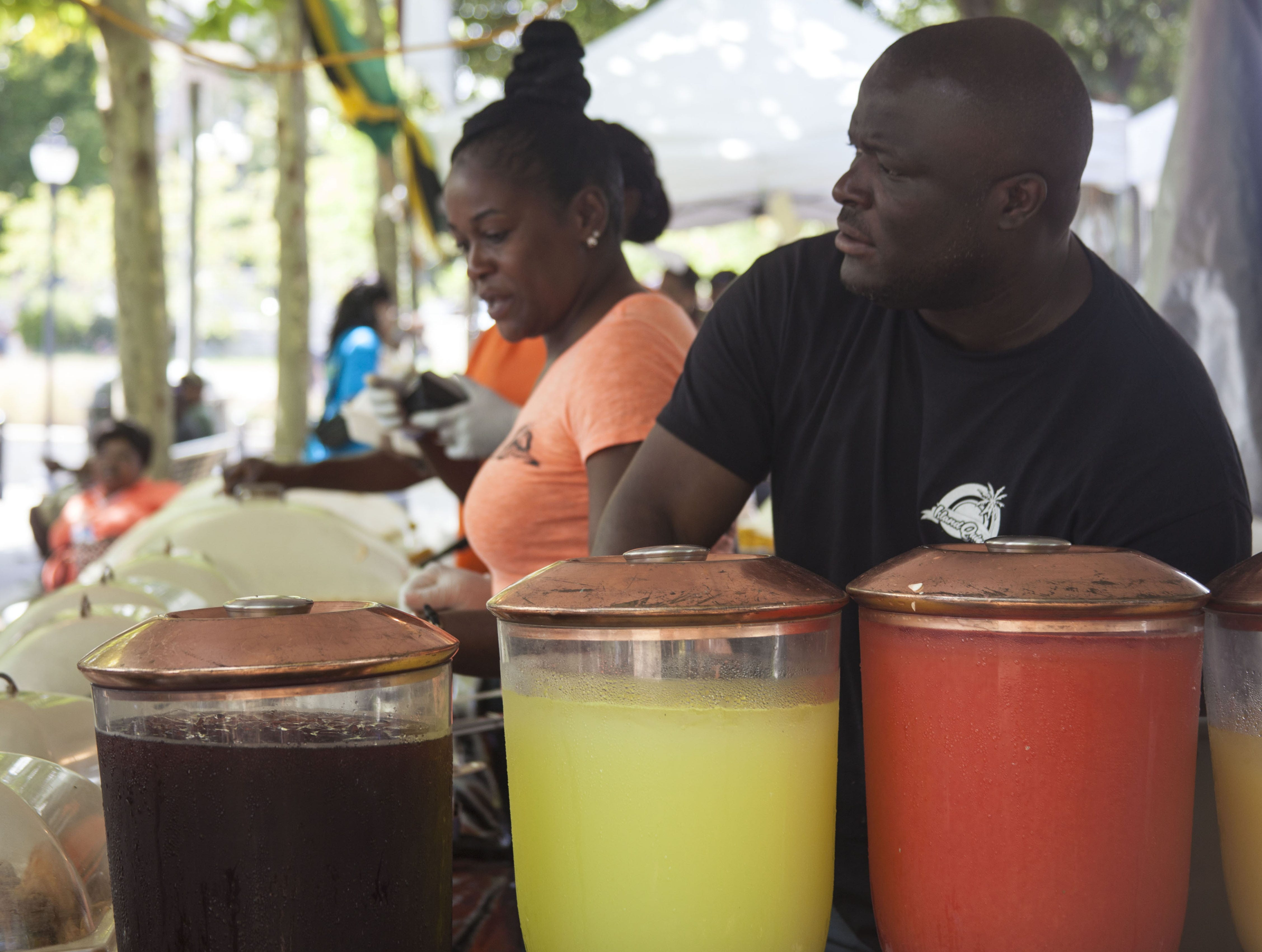 Camille and Donovan Murphy of Island Quizine serves Jamaican fare to attendees of the 2018 Goombay Festival at the Roger McGuire Green in Pack Square Park on Sept. 8, 2018.