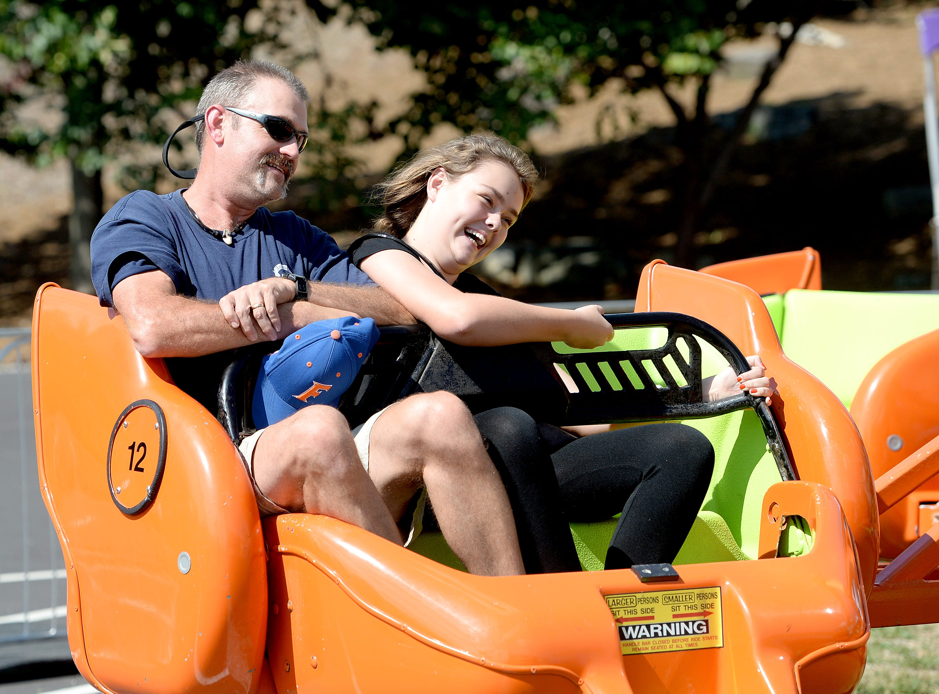 Daren Gillespie and his daughter, Gracie, 13, ride the Mixer during the NC Mountain State Fair at the WNC Agricultural Center on Sept. 7, 2018. Friday was Gracie's birthday.