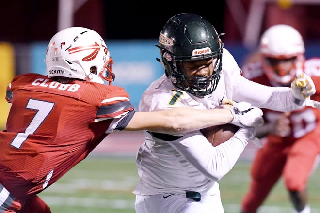 Reynolds' I'dre Bell carries the ball as Erwin's Tadan Clubb attempts to stop him Sept. 7, 2018. Reynolds won, 56-26.