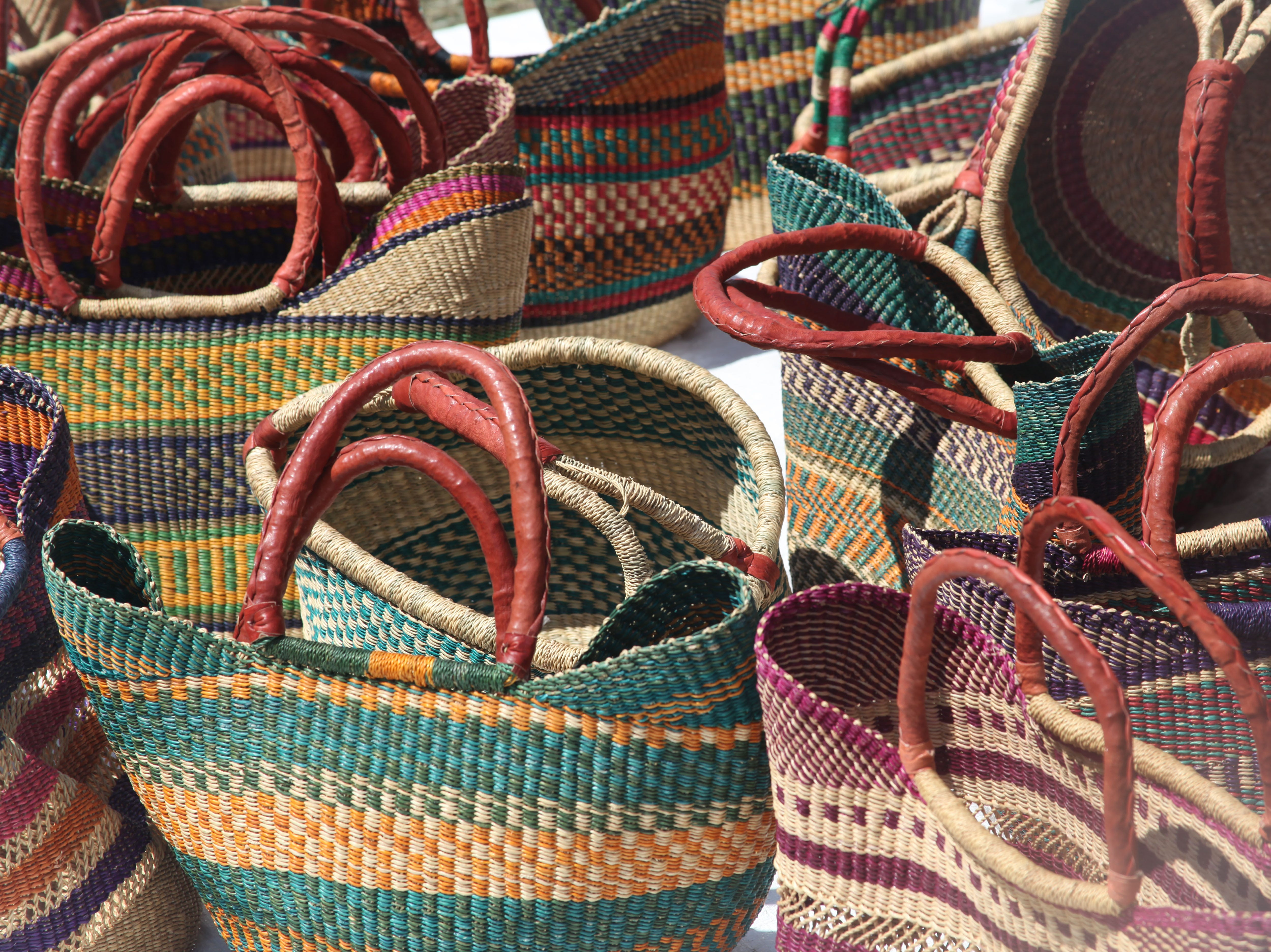 Colorful bags sit ready for purchase at the 2018 Goombay Festival at the Roger McGuire Green in Pack Square Park on Sept. 8, 2018.