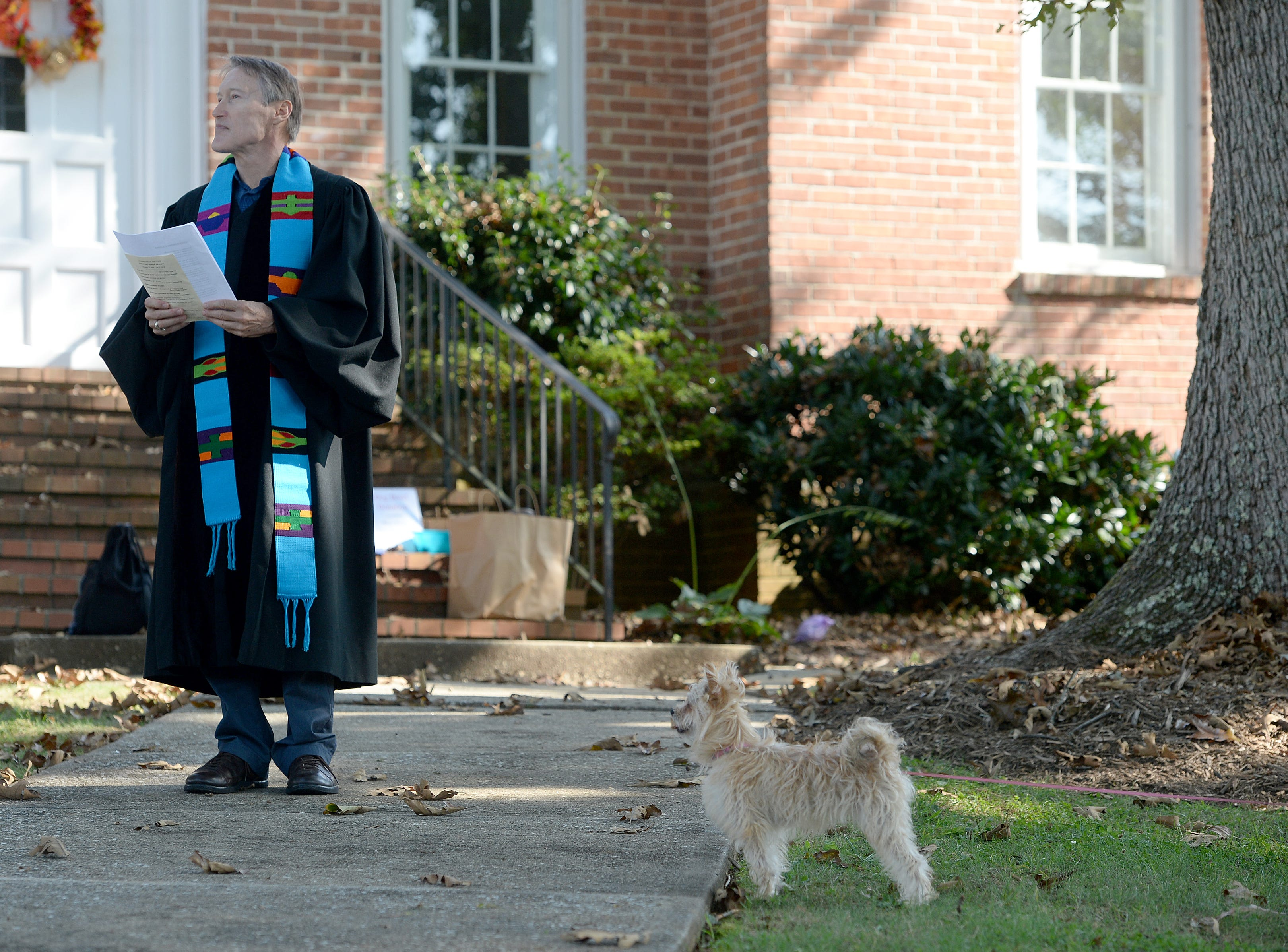Molly, the Chorkie, waits patiently for Randall Boggs to begin the 10th Annual Blessing of the Pets at Mills River Presbyterian Church on Sept. 8, 2018.