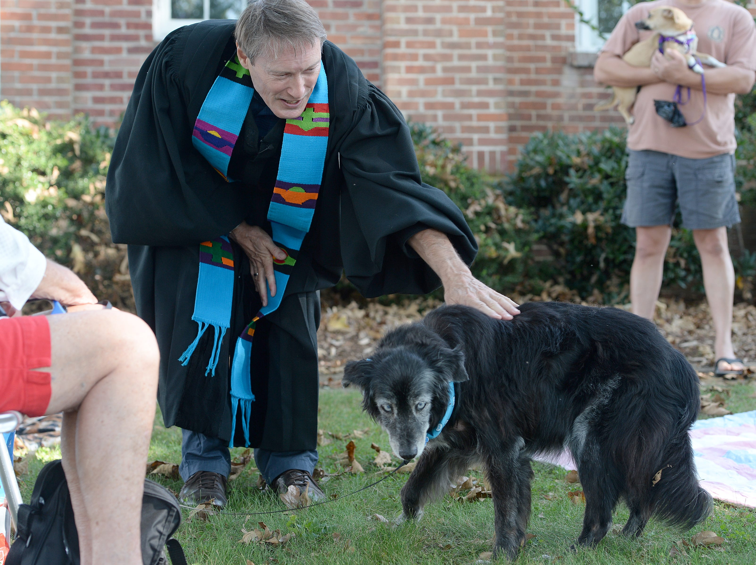 Randall Boggs blesses Susan Anderson's dog, Azul, during the 10th Annual Blessing of the Pets at Mills River Presbyterian Church on Sept. 8, 2018.
