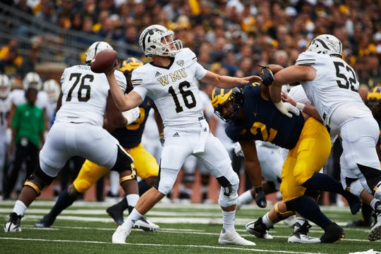 Western Michigan Broncos quarterback Jon Wassink (16) throws a pass in the first half against the Michigan Wolverines at Michigan Stadium.