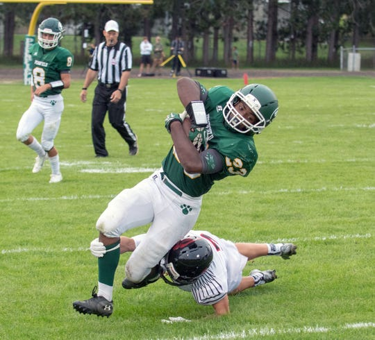 Pennfield RB Markus Roberts (23) tries to avoid a Redhawk defender Friday night.