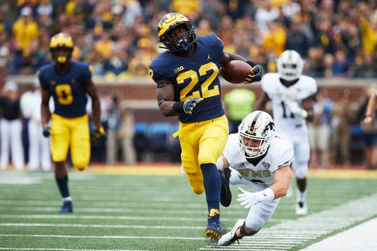 Michigan Wolverines running back Karan Higdon (22) rushes in the first half against the Western Michigan Broncos at Michigan Stadium.