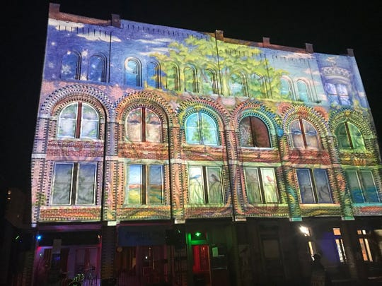 """""""Mural Moments"""" was projected on Atomic Toms on State Street at the 2018 LUMA Projection Arts Festival."""