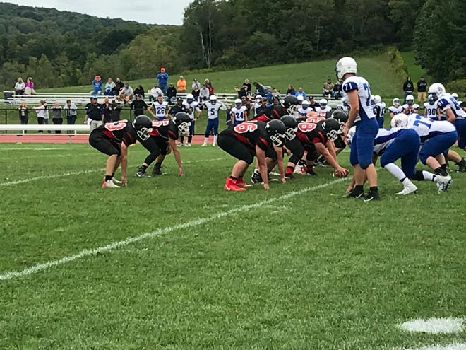 Newark Valley prepares to run a play against visiting Deposit-Hancock on Saturday. The Cardinals won, 51-6.