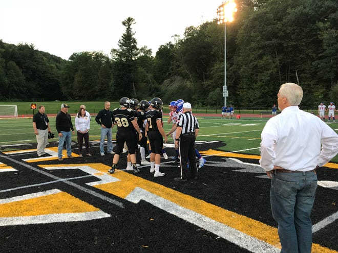 Captains for Windsor and Owego meet for the coin toss before Friday night's game at Windsor. Owego won, 21-6.