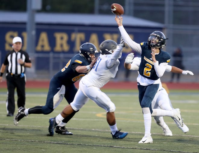 Bainbridge quarterback Gannon Winker has thrown for 14 touchdowns and rushed for 10 scores for the Spartans, who take on Garfield in a Metro League 3A playoff game Friday at Seattle Memorial Stadium.